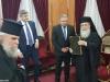 Domnul Galbur oferind Prea Fericirii Sale un prețios Minei în limba slavonă