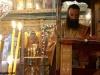 Ierodiaconul Agapie citind Sfânta Evanghelie
